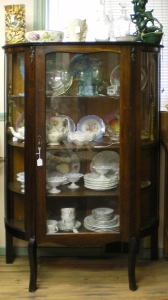Curved front maple china cabinet, circa 1910, $500.